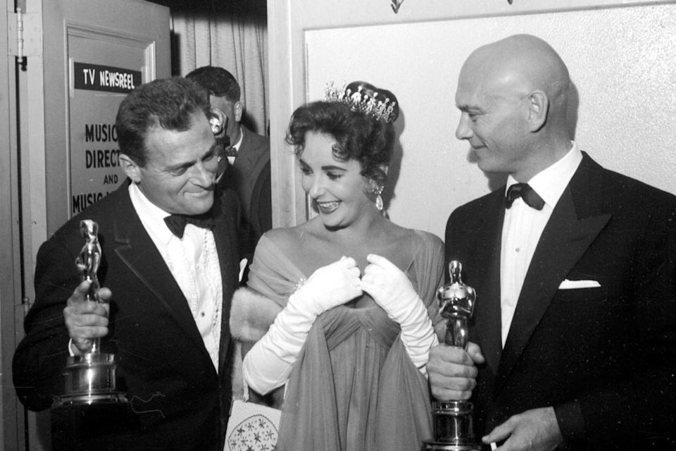 "<p><a href=""https://www.goodhousekeeping.com/life/entertainment/g3370/elizabeth-taylor-richard-burton-love-story/"" rel=""nofollow noopener"" target=""_blank"" data-ylk=""slk:Elizabeth Taylor"" class=""link rapid-noclick-resp"">Elizabeth Taylor</a> hung out backstage with winners Yul Brynner (<em><a href=""https://www.amazon.com/King-I-Deborah-Kerr/dp/B00480H3UI/ref=sr_1_1?s=instant-video&ie=UTF8&qid=1547578165&sr=1-1&keywords=The+King+and+I&tag=syn-yahoo-20&ascsubtag=%5Bartid%7C10055.g.5132%5Bsrc%7Cyahoo-us"" rel=""nofollow noopener"" target=""_blank"" data-ylk=""slk:The King and I"" class=""link rapid-noclick-resp"">The King and I</a></em>) and her third husband, Mike Todd, who won an Oscar for producing Best Picture winner <em><a href=""https://www.amazon.com/dp/B004IDBEUK?ref=sr_1_1_acs_kn_imdb_pa_dp&qid=1547578223&sr=1-1-acs&autoplay=0&tag=syn-yahoo-20&ascsubtag=%5Bartid%7C10055.g.5132%5Bsrc%7Cyahoo-us"" rel=""nofollow noopener"" target=""_blank"" data-ylk=""slk:Around the World in 80 Days"" class=""link rapid-noclick-resp"">Around the World in 80 Days</a></em>.</p>"