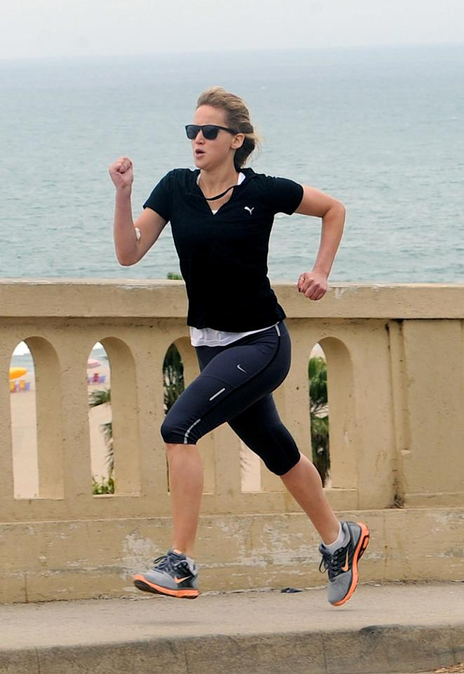 """<b>Catching a Workout<br><br></b>Jennifer Lawrence, who is said to be <a href=""""http://movies.yahoo.com/blogs/movie-talk/jennifer-lawrence-10-million-next-hunger-games-165457379.html"""">getting a huge pay raise</a> of $10 million for playing Katniss Everdeen in the """"Catching Fire"""" sequel, was seen jogging in Santa Monica, California, earlier in the summer."""