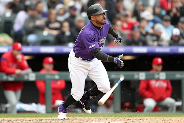 Ian Desmond of the Rockies hits an RBI single in the sixth inning against the Philadelphia Phillies at Coors Field on Sunday. (Photo by Matthew Stockman/Getty Images)