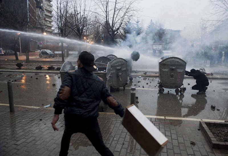 Riot police use water canon to disperse protestors during clashes in Pristina, Kosovo on January 27, 2015 (AFP Photo/Armend Nimani)