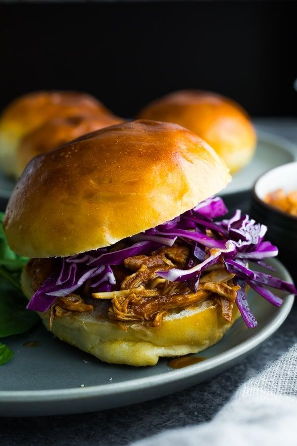 """<p>Who needs pulled pork when you can cram sandwiches with this delicious - and easy! - <a href=""""https://sweetpeasandsaffron.com/crockpot-bbq-chicken/"""" target=""""_blank"""" class=""""ga-track"""" data-ga-category=""""Related"""" data-ga-label=""""https://sweetpeasandsaffron.com/crockpot-bbq-chicken/"""" data-ga-action=""""In-Line Links"""">slow-cooker BBQ chicken</a>?</p>"""