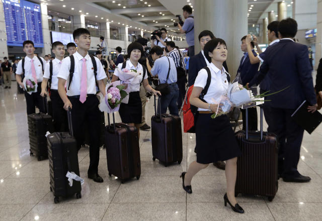 North Korea's table tennis players arrive at the Incheon International Airport in Incheon, South Korea, Sunday, July 15, 2018. North Korean table tennis players arrived in South Korea on Sunday to compete in an international tournament amid an atmosphere of detente between the rivals. (AP Photo/Ahn Young-joon)