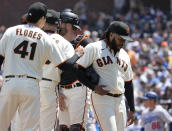 San Francisco Giants starting pitcher Johnny Cueto, right, walks off the mound as he was taken out during the sixth inning against the Los Angeles Dodgers in a baseball game Thursday, July 29, 2021, in San Francisco. (AP Photo/Tony Avelar)