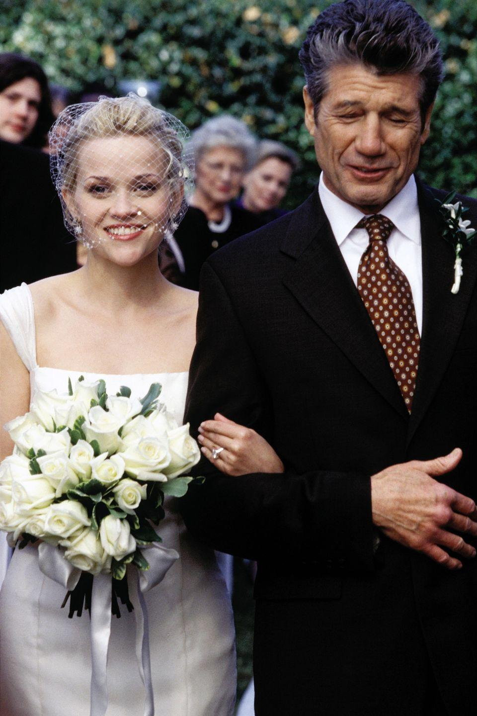 <p>In the Southern wedding of Melanie Smooter and Andrew Hennings, viewers saw Reese Witherspoon walk down the aisle in a simple cap-sleeve gown with a white bridal face net. Too bad the ceremony ended with a knockout punch, because that look was stunning.<br></p>