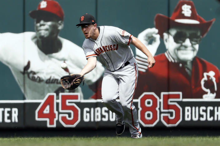 San Francisco Giants left fielder Alex Dickerson catches a fly ball by St. Louis Cardinals' Adam Wainwright during the second inning of a baseball game Monday, Sept. 2, 2019, in St. Louis. (AP Photo/Jeff Roberson)
