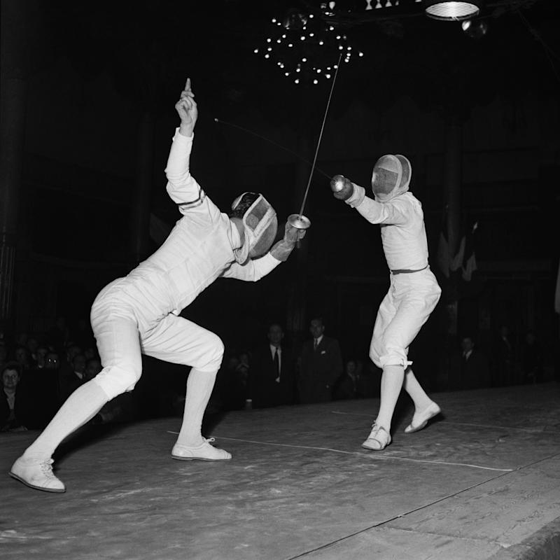 Fencing match between France and Italy. (L) Christian d'Oriola and Edoardo Mangiarotti. (Photo by Universal/Corbis/VCG via Getty Images)