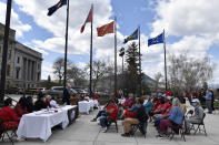Montana Gov. Greg Gianforte addresses tribal members in front of the state Capitol in Helena, Mont., during a ceremony to commemorate missing and murdered indigenous people on Wednesday, May 5, 2021. From Washington to Indigenous communities across the American Southwest, top government officials, family members and advocates gathered Wednesday as part of a call to action to address the ongoing problem of violence against Indigenous women and children. (AP Photo/Iris Samuels)