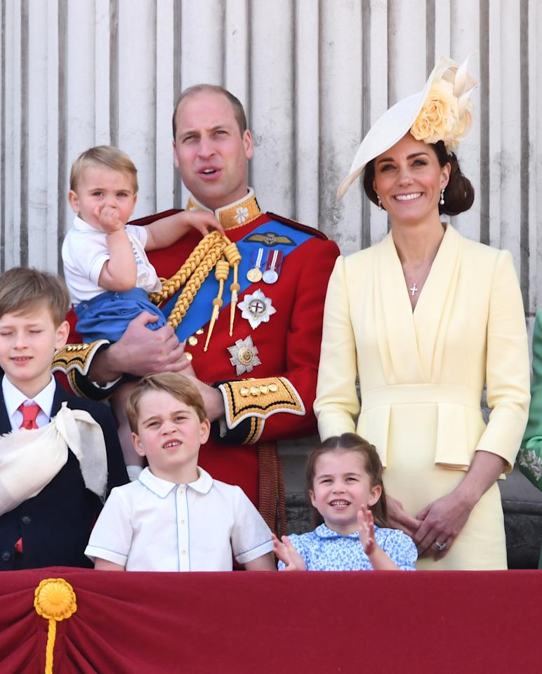 The Duchess of Cambridge wore a sunny yellow Alexander McQueen dress with peplum detailing at the waist for Trooping the Colour. She teamed it with a matching floral hat by Philip Treacy and the Queen's Bahrain pearl and diamond earrings. [Photo: PA]