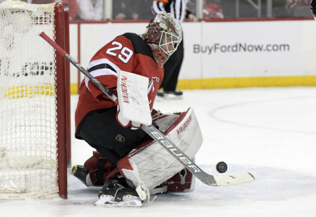 New Jersey Devils goaltender Mackenzie Blackwood (29) deflects the puck during the first period of an NHL hockey game against the Calgary Flames Wednesday, Feb. 27, 2019, in Newark, N.J. (AP Photo/Bill Kostroun)