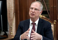 FILE - In this Friday, April 2, 2021 file photo, Russian Direct Investment Fund CEO Kirill Dmitriev gestures while speaking to Russian President Vladimir Putin during their meeting in Moscow, Russia. Dmitriev said Russia plans to provide up to 300 million doses of its Sputnik vaccine to the U.N.-backed initiative, COVAX, once the vaccine is approved by the World Health Organization.(Alexei Druzhinin, Sputnik, Kremlin Pool Photo via AP, File)