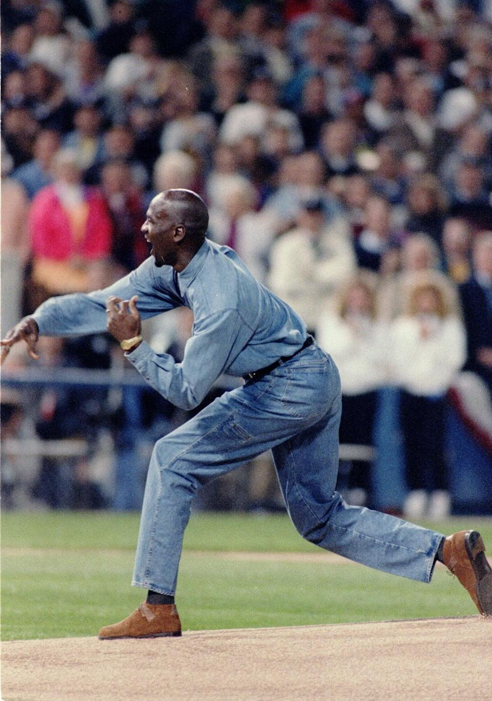 <p>Michael wore head-to-toe denim, brown suede shoes, and a timeless gold watch while throwing the first pitch at a 1993 playoff game.</p>