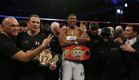 Britain Boxing - Anthony Joshua v Wladimir Klitschko IBF, IBO & WBA Super World Heavyweight Title's - Wembley Stadium, London, England - 29/4/17 Anthony Joshua celebrates with trainer Robert McCracken and his corner after winning the fight Action Images via Reuters / Andrew Couldridge Livepic