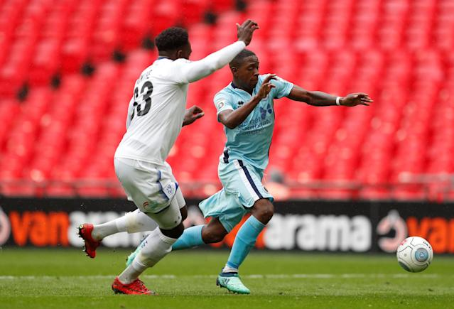Soccer Football - National League Promotion Final - Tranmere Rovers v Boreham Wood - Wembley Stadium, London, Britain - May 12, 2018 Tranmere Rovers' Manny Monthe in action with Boreham Woods' Michael Folivi Action Images/Matthew Childs