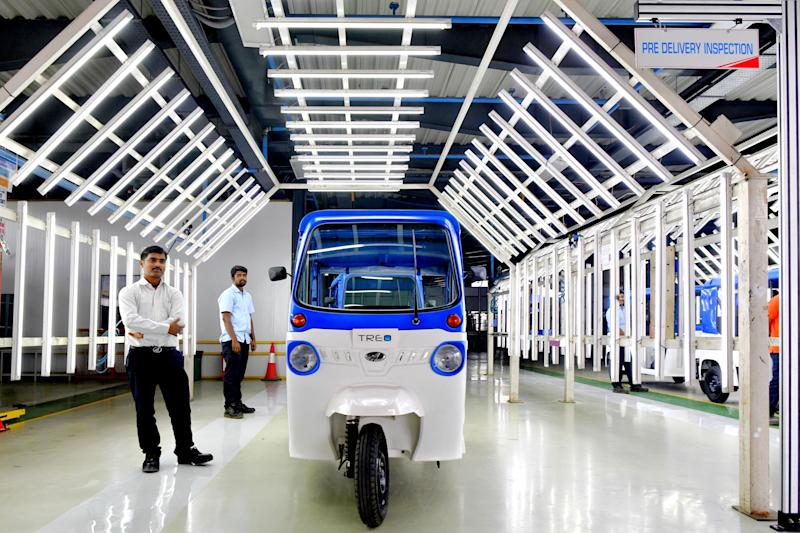 A Treo auto-rickshaw, Mahindra Electric's first lithium ion battery-powered three-wheeler, stands following rollout at an inspection bay during the inauguration of Mahindra's Electric Technology Manufacturing Hub in Karnataka, on November 15, 2018. (Photo: MANJUNATH KIRAN via Getty Images)