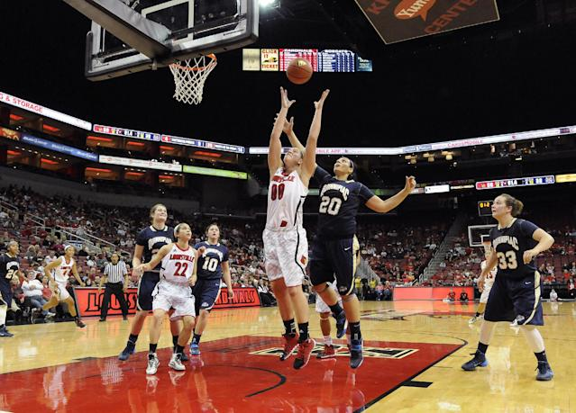 Louisville's Sara Hammond, center, attempts to grab a rebound away from the defense of Quinnipiac's Brittany McQuain during the first half of an NCAA college basketball game, Monday, Nov. 11, 2013, in Louisville, Ky. (AP Photo/Timothy D. Easley)