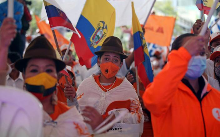 Supporters of the Ecuadorian presidential candidate Andres Arauz - CRISTINA VEGA RHOR/AFP via Getty Images