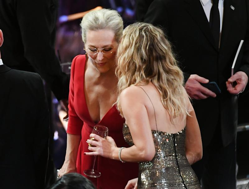 Lawrence getting friendly with Meryl Streep. (Kevin Winter via Getty Images)