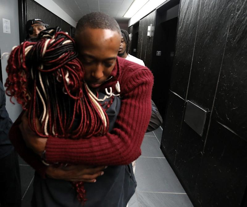 James Clay hugs the victim in his rape case after a hearing in the Frank Murphy Hall of Justice in Detroit on Thursday, Aug. 22, 2019. The two appeared in Wayne County Circuit Judge Wanda Evans' courtroom for a hearing on whether he should be granted a new trial.