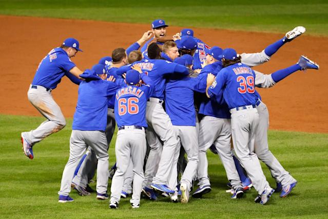 <p>The Chicago Cubs celebrate after defeating the Cleveland Indians 8-7 in Game Seven of the 2016 World Series at Progressive Field on November 2, 2016 in Cleveland, Ohio. The Cubs win their first World Series in 108 years. (Photo by Gregory Shamus/Getty Images) </p>