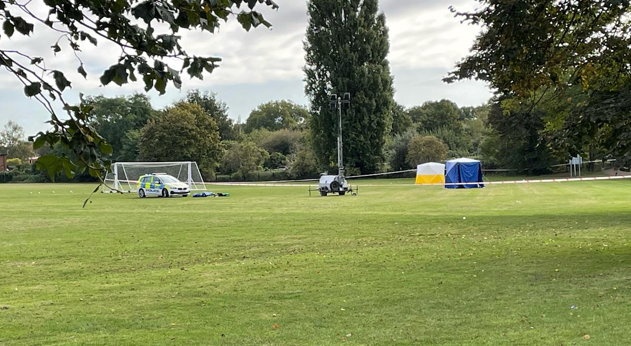 A police car and forensic tents at the scene on a playing field in Craneford Way, Twickenham.