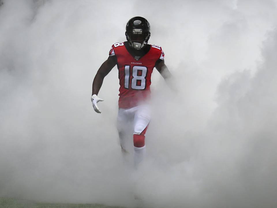 Atlanta Falcons Wide Receiver Calvin Ridley (18) sprints onto the field before the NFL game