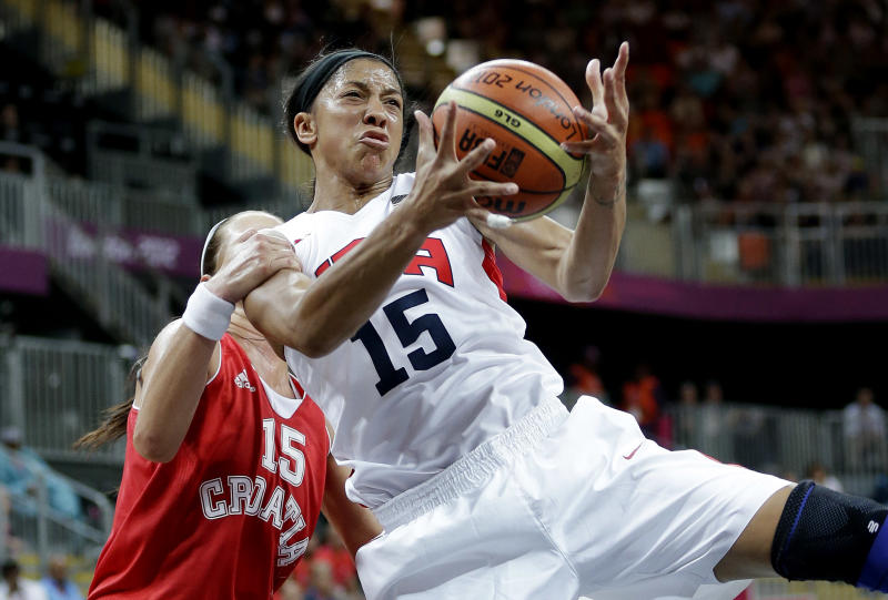 USA's Candace Parker, right, is grabed from behind by Croatia's Jelena Ivezic, left, during the second half of a preliminary women's basketball game at the 2012 Summer Olympics, Saturday, July 28, 2012, in London. (AP Photo/Eric Gay)
