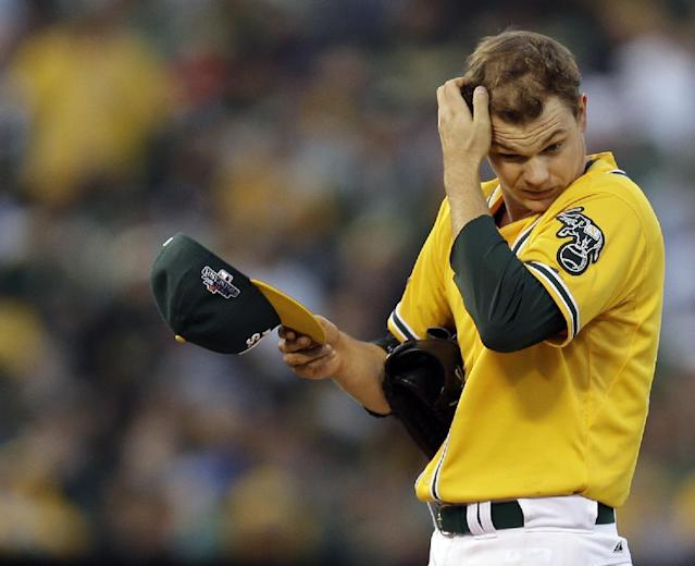 Oakland Athletics starting pitcher Sonny Gray (54) adjusts his cap after loading the bases in the fourth inning of Game 5 of an American League baseball division series against the Detroit Tigers in Oakland, Calif., Thursday, Oct. 10, 2013. (AP Photo/Ben Margot)