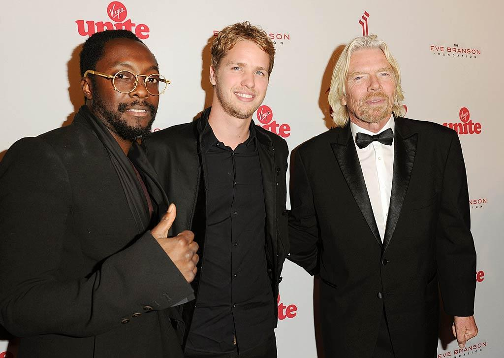 "The Black Eyed Peas' will.i.am  hung out with Sam Branson, son of Richard, and the evening's host himself. The singer revealed Wednesday that he'll also be making an appearance at Sunday's American Music Awards, singing his song ""T.H.E."" (what is it with this guy and periods?!) along with Jennifer Lopez. (11/16/2011)"