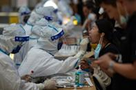A medical worker performs a Covid test in Jiangsu province, China