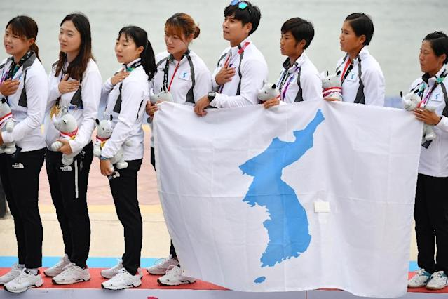 The two Koreas formed joint teams in rowing, canoeing and women's basketball at the Asian Games in Indonesia, winning one gold, one silver and two bronze medals (AFP Photo/ADEK BERRY)