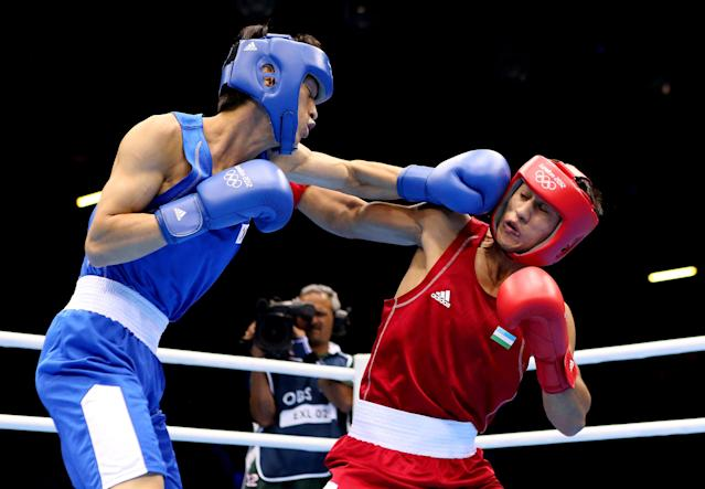 LONDON, ENGLAND - AUGUST 06: Han Soonchul of Korea (L) in action with Fazliddin Gaibnazarov of Uzbekistan during the Men's Light (60kg) Boxing on Day 10 of the London 2012 Olympic Games at ExCeL on August 6, 2012 in London, England. (Photo by Scott Heavey/Getty Images)