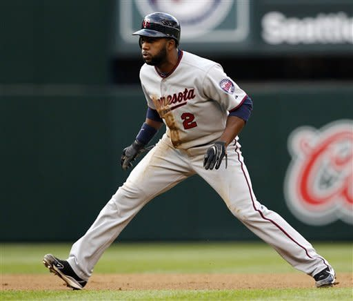 Minnesota Twins' Denard Span leads off at second base against the Seattle Mariners in the fourth inning of a baseball game, Saturday, May 5, 2012, in Seattle. Span had the Twins only hit in the game, a single in the fourth. The Mariners won 7-0. (AP Photo/Elaine Thompson)