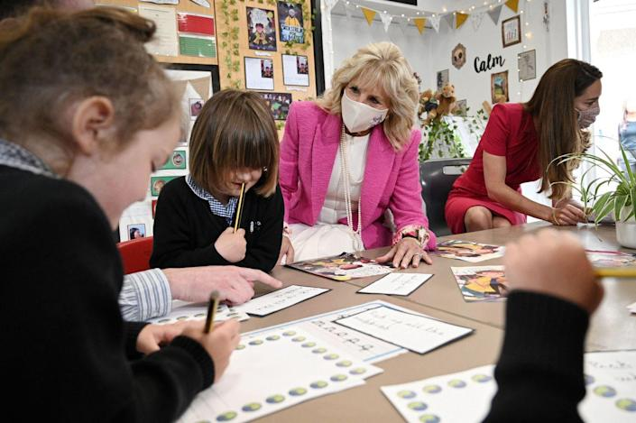 <p>Before she was an English professor, Dr. Biden was a high school teacher and reading specialist. Here, she chats with students and helps them with their schoolwork. </p>