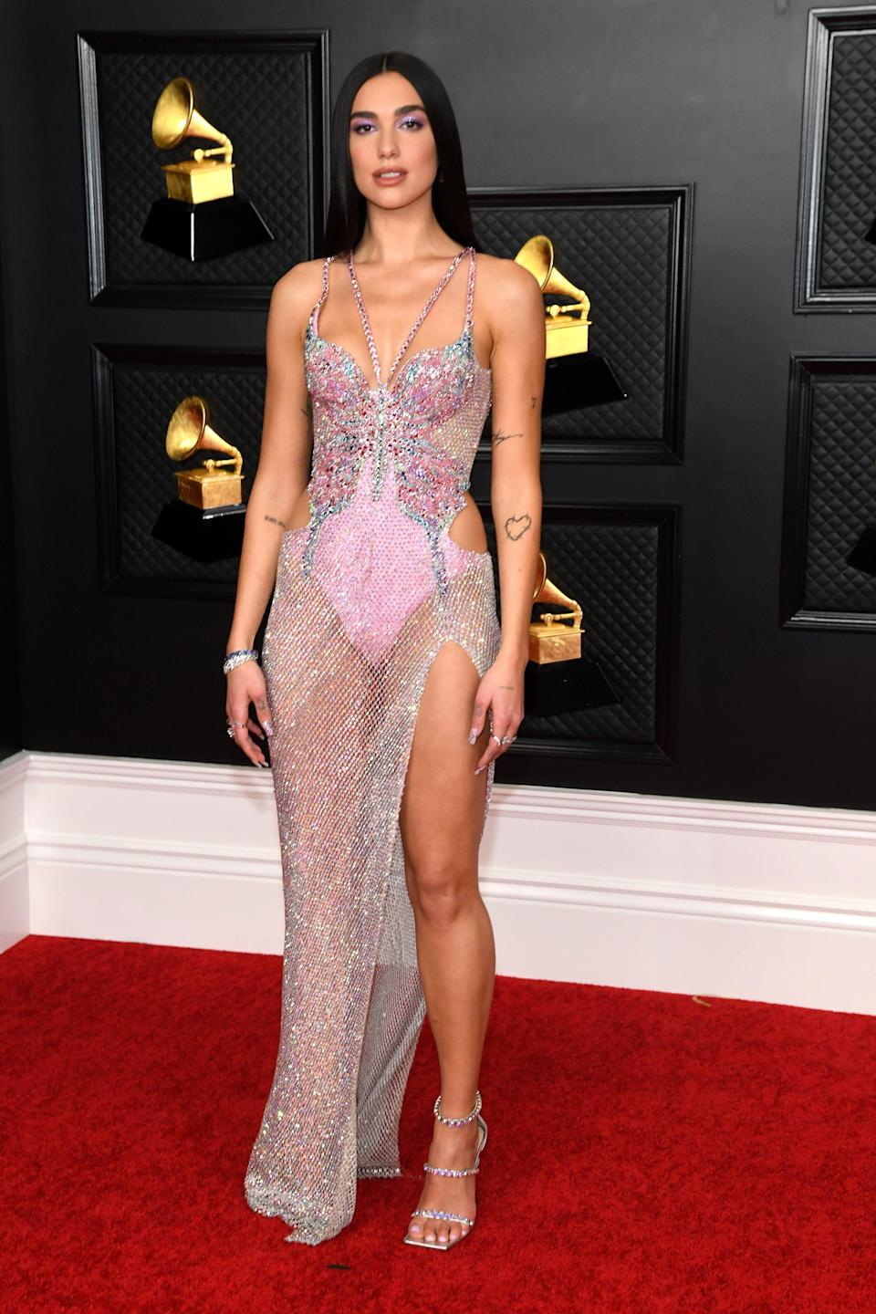 """<h2>Dua Lipa in Atelier Versace</h2><br>Dua Lipa is nothing short of an ethereal being in this sparkling, butterfly-inspired Versace gown. <span class=""""copyright"""">Photo: Kevin Mazur/Getty Images.</span>"""