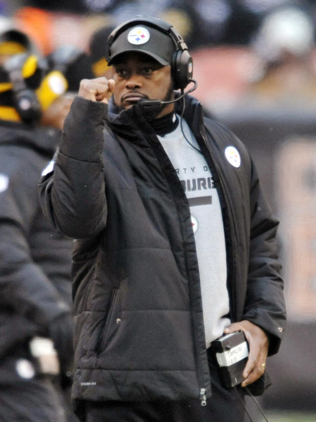 Pittsburgh Steelers head coach Mike Tomlin pumps his fist after a first down against the Cleveland Browns in the fourth quarter of an NFL football game on Sunday, Nov. 24, 2013. (AP Photo/David Richard)