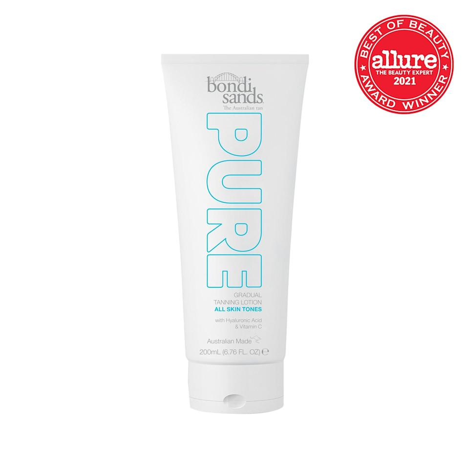 """A gradual bronzer with the soul of a moisturizer, <strong>Bondi Sands Pure Gradual Tanning Lotion</strong> transforms skin into dewy, glowy perfection with <a href=""""https://www.allure.com/gallery/best-hyaluronic-acid-serum?mbid=synd_yahoo_rss"""" rel=""""nofollow noopener"""" target=""""_blank"""" data-ylk=""""slk:hyaluronic acid"""" class=""""link rapid-noclick-resp"""">hyaluronic acid</a> and a subtle tint."""