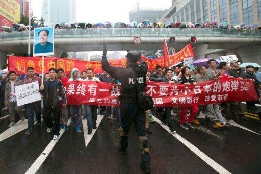 <p>A Chinese riot policeman directs protesters in Chengdu, Sichuan province. Thousands of anti-Japanese demonstrators have mounted protests in cities across China over disputed islands in the East China Sea, a day after an attempt to storm Tokyo's embassy in the capital.</p>
