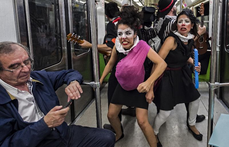"Six philosophy graduates founded the group ""Ponte la del Metro"" to restore metro etiquette in 2010, and later created Claustrofobos (AFP Photo/Omar Torres)"