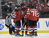 New Jersey Devils center Nico Hischier (13) celebrates his goal with teammates during the first period of an NHL hockey game against the Toronto Maple Leafs, Friday, Dec. 27, 2019, in Newark, N.J. (AP Photo/Bill Kostroun)
