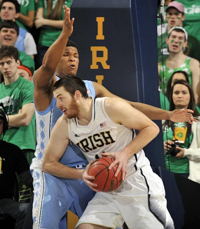 Notre Dame forward Garrick Sherman drives the lane as Nortrh Carolina forward Kennedy Meeks defends during the first half of an NCAA college basketball game Saturday, Feb. 8, 2014, in South Bend, Ind. (AP Photo/Joe Raymond)