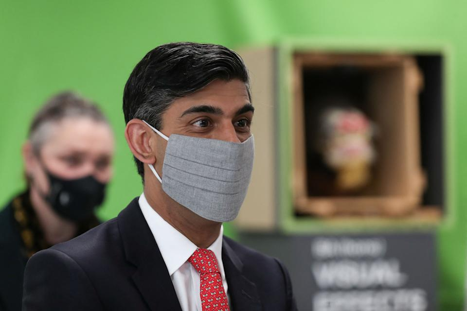 Britain's Chancellor of the Exchequer Rishi Sunak (R), reacts during a local by-election campaign visit to the Northern School of Art in Hartlepool, north east England on, April 30, 2021. (Photo by LEE SMITH / POOL / AFP) (Photo by LEE SMITH/POOL/AFP via Getty Images)