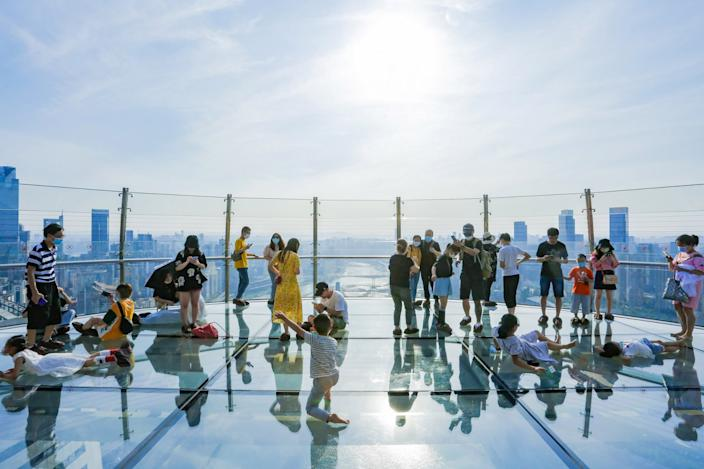 Tourists were quick to sign up for a chance to stand on the horizontal tower's stunning observation deck.