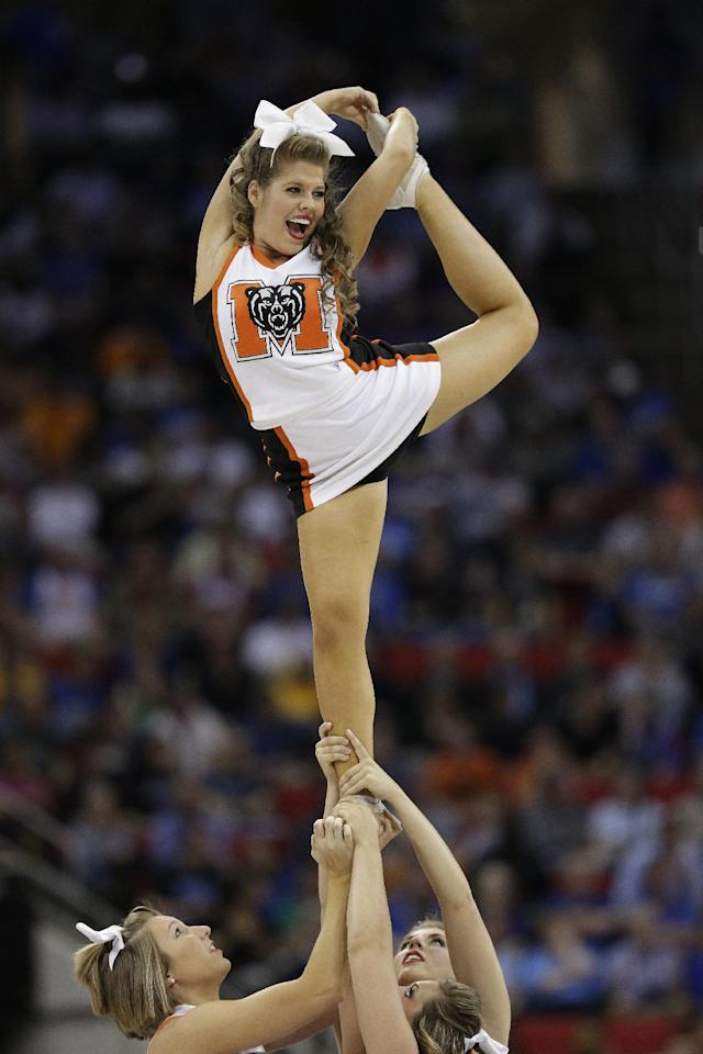 Mercer cheerleaders perform during the second half of an NCAA college basketball second-round game against Duke , Friday, March 21, 2014, in Raleigh, N.C. (AP Photo/Chuck Burton)