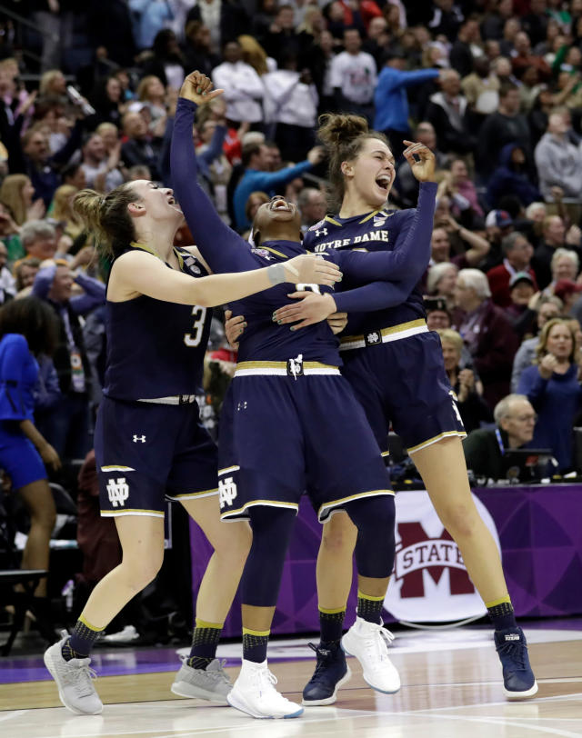 FILE - In this April 1, 2018, file photo, Notre Dame's Arike Ogunbowale, center, celebrates with teammates Marina Mabrey, left, and Kathryn Westbeld after defeating Mississippi State in the final of the women's NCAA Final Four college basketball tournament, in Columbus, Ohio. Both Notre Dame and Louisville enter the season as defending women's basketball champions. (AP Photo/Tony Dejak, File)