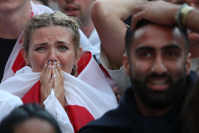 Two England fans react to Croatia's goal.