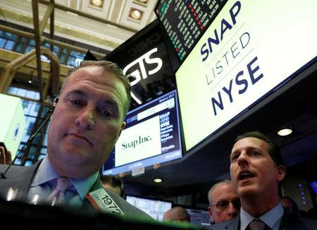 Specialist Trader Glen Carell (R) gives a price for Snap Inc. during the company's IPO on the floor of the New York Stock Exchange (NYSE) in New York, U.S. on March 2, 2017. REUTERS/Brendan McDermid/File Photo