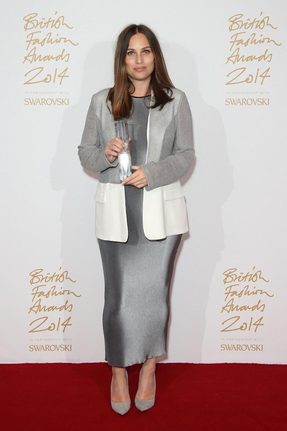 LONDON, ENGLAND - DECEMBER 01: Designer Prism poses in the winners room with the Emerging Accessory Designer Award at the British Fashion Awards at London Coliseum on December 1, 2014 in London, England. (Photo by Mike Marsland/WireImage)