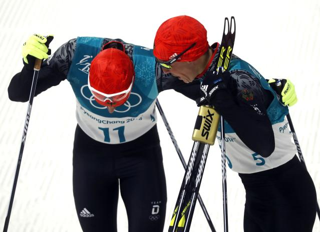 Nordic Combined Events – Pyeongchang 2018 Winter Olympics – Men's Individual 10km Final – Alpensia Cross-Country Skiing Centre - Pyeongchang, South Korea – February 14, 2018 - Johannes Rydzek of Germany and Eric Frenzel of Germany react after the finish. REUTERS/Kai Pfaffenbach