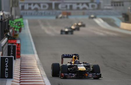 Red Bull Formula One driver Sebastian Vettel of Germany drives during the Abu Dhabi F1 Grand Prix at the Yas Marina circuit on Yas Island, November 3, 2013. REUTERS/Steve Crisp