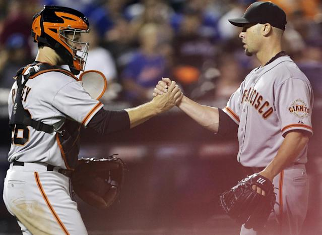 San Francisco Giants starting pitcher Ryan Vogelsong, right, celebrates with catcher Buster Posey after a baseball game against the New York Mets on Friday, Aug. 1, 2014, in New York. The Gaints won 5-1. (AP Photo/Frank Franklin II)